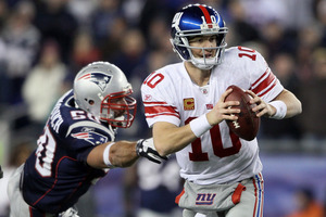 Just shut your eyes and throw, Eli. It always seems to work out for you.  (Photo by Elsa/Getty Images)
