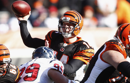 CINCINNATI, OH - DECEMBER 11:  Andy Dalton #14 of the Cincinnati Bengals throws the football downfield during the game against the Houston Texans at Paul Brown Stadium on December 11, 2011 in Cincinnati, Ohio.  The Texans defeated the Bengals 20-19.  (Photo by John Grieshop/Getty Images)