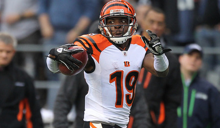 SEATTLE - OCTOBER 30:  Brandon Tate #19 of the Cincinnati Bengals returns a punt for a touchdown against David Vobora #54 of the Seattle Seahawks at CenturyLink Field on October 30, 2011 in Seattle, Washington. The Bengals defeated the Seahawks 34-12.(Photo by Otto Greule Jr/Getty Images)