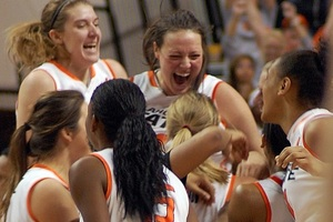 Members of the Oklahoma State women's basketball team celebrate their Bedlam victory on Saturday. (Photo by Lynn Jacobsen)