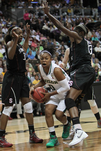 April 1, 2012; Denver, CO, USA; Baylor Bears guard Odyssey Sims (0) controls the ball between Stanford Cardinal forward Nnemkadi Ogwumike (left) and forward Chiney Ogwumike (right) during the first half in the semifinals of the 2012 NCAA women's basketball Final Four at the Pepsi Center. Chris Humphreys-US PRESSWIRE