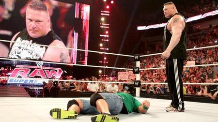 Photo of Brock Lesnar standing over John Cena via WWE.com.