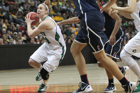 April 1, 2012; Denver, CO, USA; Notre Dame Fighting Irish guard Natalie Novosel (21) drives to the basket against the Connecticut Huskies during the second half in the semifinals of the 2012 NCAA women's basketball Final Four at the Pepsi Center. Chris Humphreys-US PRESSWIRE