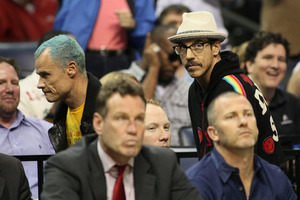 Apr 11, 2012; Memphis, TN, USA; Red Hot Chili Peppers bassist Flea and singer Anthony Kiedis watch the game between the Memphis Grizzlies and Phoenix Suns at the FedEx Forum.  Memphis defeated Phoenix 104-93.  Mandatory Credit: Nelson Chenault-US PRESSWIRE