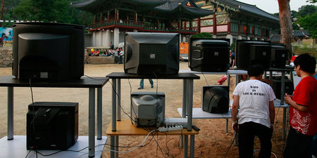 SEOUL, SOUTH KOREA - JUNE 21:  People set up TVs to watch the North Korean (Korea DPR) team in their Group G match against Portugal at the Bongeun Buddhist Temple on June 21, 2010 in Seoul, South Korea.  (Photo by Chung Sung-Jun/Getty Images)