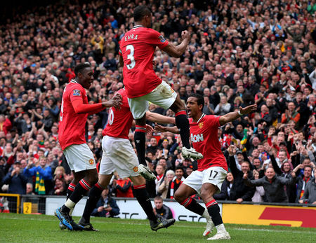 MANCHESTER, ENGLAND - APRIL 22:  Nani of Manchester United celebrates scoring his team's third goal with his team mates during the Barclays Premier League match between Manchester United and Everton at Old Trafford on April 22, 2012 in Manchester, England.  (Photo by Alex Livesey/Getty Images)