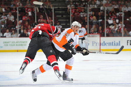 NEWARK, NJ - OCTOBER 8: Ilya Kovalchuk #17 of the New Jersey Devils is owned by Matt Carle #25 of the Philadelphia Flyers during the first period at the Prudential Center on October 8, 2011 in Newark, New Jersey. (Photo by Christopher Pasatieri/Getty Images)