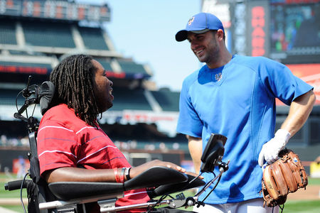 NEW YORK, NY - AUGUST 20:  Former Rutgers football player Eric LeGrand (L) speaks with David Wright #5 of the New York Mets before a game against the Milwaukee Brewers at Citi Field on August 20, 2011 in the Flushing neighborhood of the Queens borough of New York City. LeGrand was paralyzed during a kickoff return in October 2010. (Photo by Patrick McDermott/Getty Images)