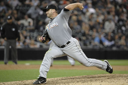SAN DIEGO, CA - MAY 5: Mark Buehrle #56 of the Miami Marlins pitches during the ninth inning of a baseball game against the San Diego Padres at Petco Park on May 5, 2012 in San Diego, California.  The Marlins won 4-1. (Photo by Denis Poroy/Getty Images)