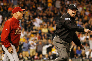 PITTSBURGH, PA - MAY 11:  First base umpire Jim Joyce throws out manager Brad Mills #2 of the Houston Astros during the game against the Pittsburgh Pirates on May 11, 2012 at PNC Park in Pittsburgh, Pennsylvania.  (Photo by Jared Wickerham/Getty Images)