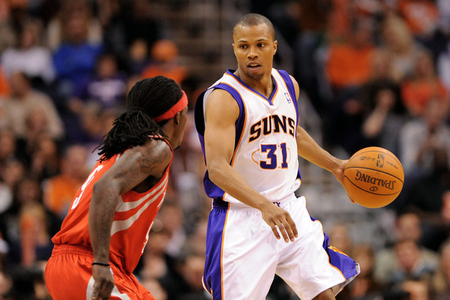 Mar. 18, 2012; Phoenix, AZ, USA; Phoenix Suns guard Sebastian Telfair (31) handles the ball against the Houston Rockets guard Courtney Fortson (9) during the second half at the US Airways Center. The Suns defeated the Rockets 99-86. Mandatory Credit: Jennifer Stewart-US PRESSWIRE.