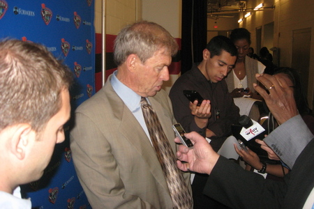New York Liberty coach John Whisenant fields a question from the media after a loss to the Minnesota Lynx. Photo by Ray Floriani.