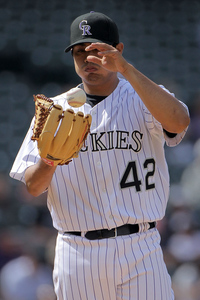 DENVER - APRIL 15:  Starting pitcher Jorge De La Rosa #42 of the Colorado Rockies reacts as he works against the New York Mets at Coors Field on April 15, 2010 in Denver, Colorado. All the players in MLB wore #42 today in honor of Jackie Robinson Day.  (Photo by Doug Pensinger/Getty Images)
