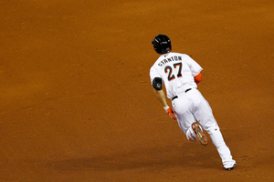 MIAMI, FL - MAY 29: Giancarlo Stanton #27 of the Miami Marlins rounds first on an RBI double during a game against the Washington Nationals at Marlins Park on May 29, 2012 in Miami, Florida. Stanton has carried the Marlins' offense during their fiery May. (Photo by Mike Ehrmann/Getty Images)
