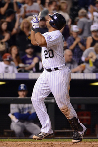 DENVER, CO - JUNE 01:  Wilin Rosario #20 of the Colorado Rockies celebrates as he crosses the plate on his two run home run off of Chris Capuano #35 of the Los Angeles Dodgers in the sixth inning at Coors Field on June 1, 2012 in Denver, Colorado.  (Photo by Doug Pensinger/Getty Images)