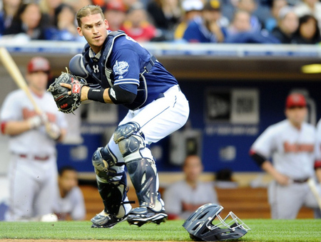 June 2, 2012; San Diego, CA, USA; San Diego Padres catcher Yasmani Grandal (12) recovers a dropped third strike to throw the batter out at first base to end the eighth inning against the Arizona Diamondbacks at Petco Park. Mandatory Credit: Christopher Hanewinckel-US PRESSWIRE