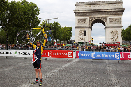 PARIS, FRANCE - JULY 24:  Cadel Evans of team BMC poses for photos as he takes part in a victory parade after winning the 2011 Tour de France after the twenty first and final stage of Le Tour de France 2011, from Creteil to the Champs-Elysees in Paris on July 24, 2011 in Paris, France.  (Photo by Bryn Lennon/Getty Images)