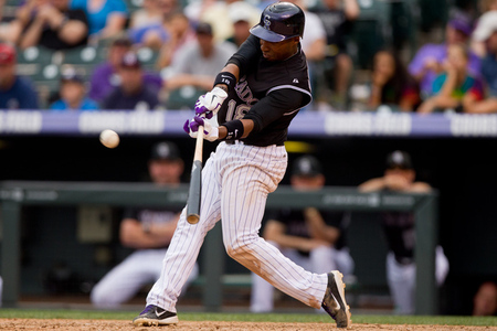 DENVER, CO - JUNE 28:  Jonathan Herrera #18 of the Colorado Rockies doubles to left-center in the 11th inning against the Washington Nationals at Coors Field on June 28, 2012 in Denver, Colorado.  Herrera went on to score the winning run on a single by Marco Scutaro as the  Rockies defeated the Nationals 11-10 in 11 innings.  (Photo by Justin Edmonds/Getty Images)