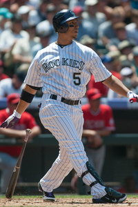 DENVER, CO - JUNE 10:  Carlos Gonzalez #5 of the Colorado Rockies hits a home run during the second inning of a game against the Los Angeles Angels of Anaheim at Coors Field on June 10, 2012 in Denver, Colorado. The Angels defeated the Rockies 10-8. (Photo by Dustin Bradford/Getty Images)
