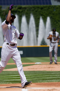 DENVER, CO - JULY 18:  Dexter Fowler #24 of the Colorado Rockies celebrates as he crosses home plate after hitting a home run off of starting pitcher James McDonald #53 of the Pittsburgh Pirates during the first inning at Coors Field on July 18, 2012 in Denver, Colorado.  (Photo by Justin Edmonds/Getty Images)