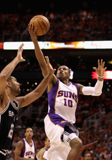 PHOENIX - MAY 03:  Leandro Barbosa #10 of the Phoenix Suns puts up a shot against the San Antonio Spurs during Game One of the Western Conference Semifinals of the 2010 NBA Playoffs at US Airways Center on May 3, 2010 in Phoenix, Arizona. The Suns defeated the Spurs 111-102 to take a 1-0 series lead.  NOTE TO USER: User expressly acknowledges and agrees that, by downloading and or using this photograph, User is consenting to the terms and conditions of the Getty Images License Agreement.  (Photo by Christian Petersen/Getty Images)
