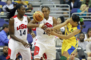 July 16, 2012; Washington, DC; Tamika Catchings (10) battles for the ball with Brazil guard Castro Marques (8) in the first half at Verizon Center. Team USA won 99-67. (Credit: Geoff Burke-US PRESSWIRE)