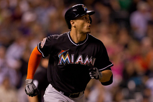 DENVER, CO - AUGUST 17:  Giancarlo Stanton #27 of the Miami Marlins trots to first base after hitting a solo home run during the sixth inning against the Colorado Rockies at Coors Field on August 17, 2012 in Denver, Colorado.  (Photo by Justin Edmonds/Getty Images)