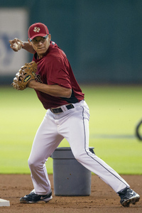 HOUSTON,TX-JUNE 07:  Carlos Correa, the Astros first-overall selection in the 2012 MLB First Year Player Draft takes infield practice on June 7, 2012 at Minute Maid Park in Houston, Texas.  (Photo by Bob Levey/Getty Images)