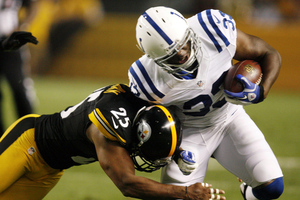 August 19, 2012; Pittsburgh, PA, USA; Indianapolis Colts running back Vick Ballard (33) is tackled by Pittsburgh Steelers defensive back Ryan Clark (25) during the second quarter at Heinz Field. Mandatory Credit: Charles LeClaire-US PRESSWIRE