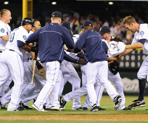 Seattle, WA, USA; The Seattle Mariners celebrate after defeating the Minnesota Twins at Safeco Field. Seattle defeated Minnesota 3-2. Credit: Steven Bisig-US PRESSWIRE