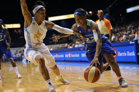 July 6, 2012; Chicago, IL, USA; New York Liberty guard Cappie Pondexter (23) is defended by Chicago Sky forward Tamera Young (1) during the first half at the Allstate Arena.  Photo by Rob Grabowski-US PRESSWIRE.