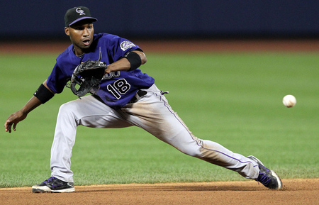 August 22, 2012; New York, NY, USA; Colorado Rockies shortstop Jonathan Herrera (18) fields a ground ball by New York Mets shortstop Ruben Tejada (not pictured) during the seventh inning of a game at Citi Field. Mandatory Credit: Brad Penner-US PRESSWIRE