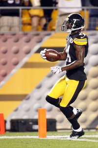 August 19, 2012; Pittsburgh, PA, USA; Pittsburgh Steelers defensive back Ike Taylor (24) crosses the goal line to score on a 49 yard interception for a touchdown against the Indianapolis Colts during the first quarter at Heinz Field. Mandatory Credit: Charles LeClaire-US PRESSWIRE