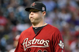 September 02, 2012; Houston, TX, USA; Houston Astros pitcher Bud Norris (20) walks off the mound in the second inning against the Cincinnati Reds at Minute Maid Park. Mandatory Credit: Troy Taormina-US PRESSWIRE