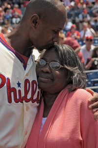 May 13, 2012; Philadelphia, PA USA; Philadelphia Phillies left fielder Juan Pierre (10) gives his mother Derry Pierre a kiss during a Mother's Day ceremony before a game against the San Diego Padres at Citizens Bank Park. Mandatory Credit: Eric Hartline-US PRESSWIRE