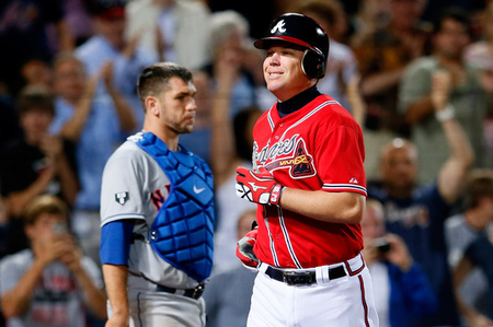 Chipper Jones smiles as he crosses the plate after yet another home run against the New York Mets.