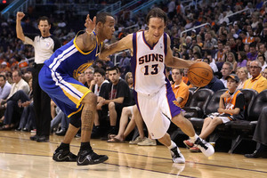 PHOENIX - OCTOBER 19:  Steve Nash #13 of the Phoenix Suns drives the ball past Monta Ellis #8 of the Golden State Warriors  (Photo by Christian Petersen/Getty Images)
