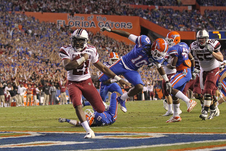GAINESVILLE FL - NOVEMBER 13:  Marcus Lattimore #21 of the South Carolina Gamecocks rushes for a touchdown during a game against the Florida Gators at Ben Hill Griffin Stadium on November 13 2010 in Gainesville Florida.  (Photo by Mike Ehrmann/Getty Images)