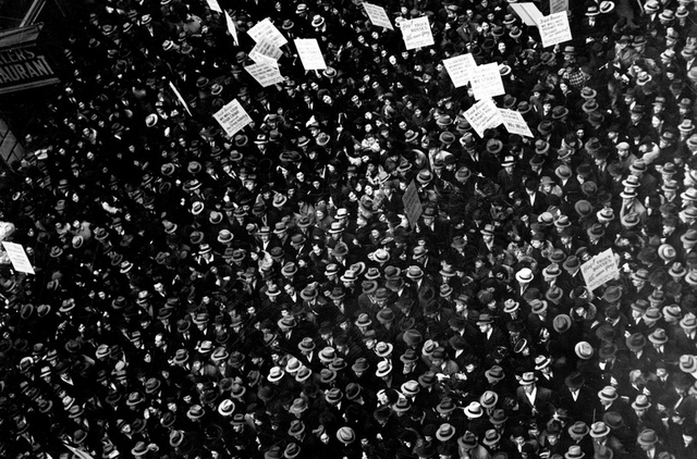 black and white crowd with signs