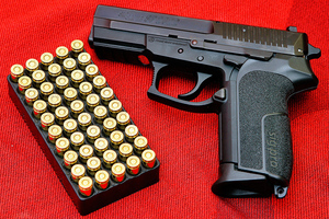 Pistol gun SIG Pro from Wikimedia Commons
