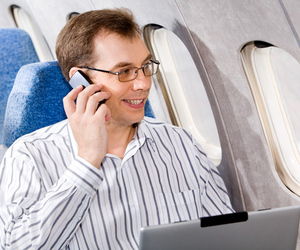 Man on cellphone in plane http://www.shutterstock.com/pic-6689698/stock-photo-portrait-of-business-man-calling-by-phone-in-the-airplane.html