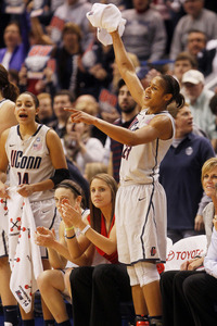 Rasing the Towel: UConn is headed to Indy! (Photo by Jim Rogash/Getty Images)