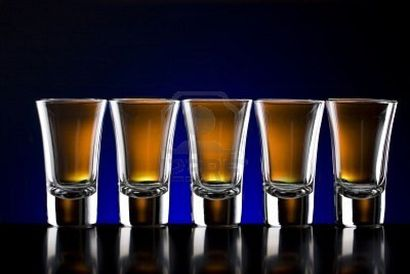5450292-five-shot-glasses-on-a-table