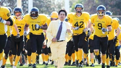 Barristers_bowl_coach_eli_abad_leadaing_the_team_onto_the_field