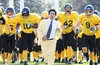 Barristers_bowl_coach_eli_abad_leadaing_the_team_onto_the_field_small
