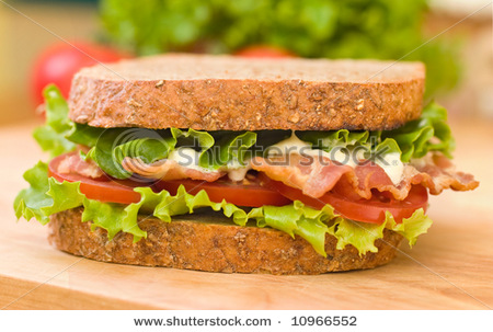 Stock-photo-blt-bacon-lettuce-tomato-sandwich-with-mayonnaise-with-fresh-vegetables-as-background-10966552_medium