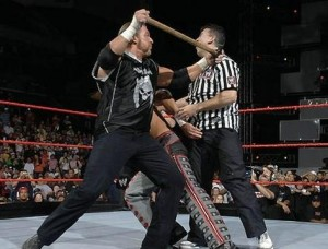 Triple-h-hitting-referee-with-hammer-in-the-ring-300x228_medium