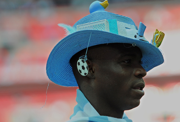 Mario-Balotelli in a funny hat. Haha.