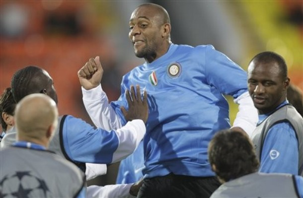 I cant tell if Maicon is going to kiss Mario or crush him.