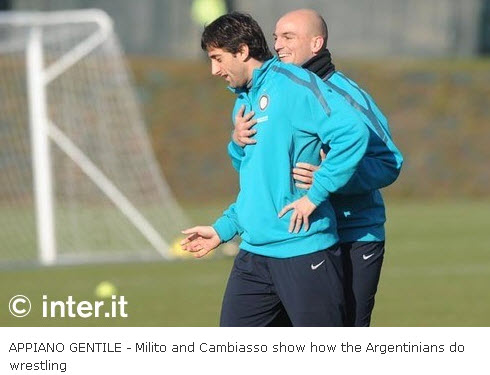 Cambiasso and Milito wrestling